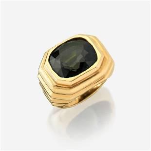 A color change alexandrite and eighteen karat gold ring