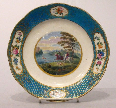 14: A Sevres Porcelain Plate, circa 1775, The gilt rim