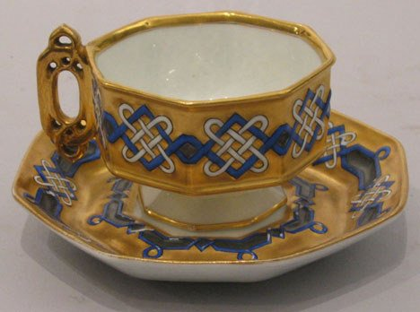 21: A Russian Porcelain Gilt and Decorated Cup and Sauc