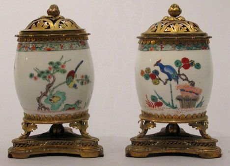 30: Pair of Chantilly mounted porcelain brule parfum