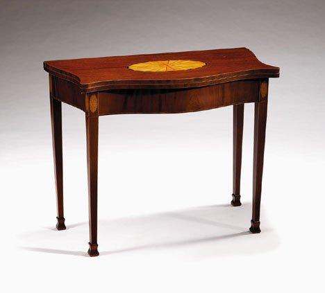 1011: George III mahogany & inlaid serpentine games tab