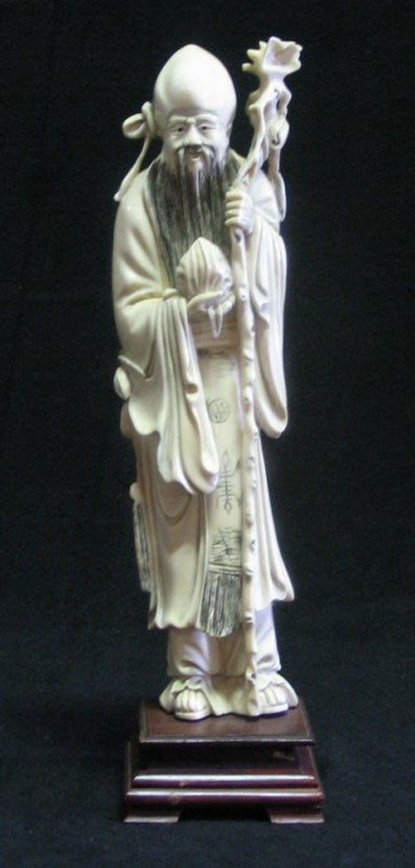 21016: Chinese carved ivory figure of an immortal, earl