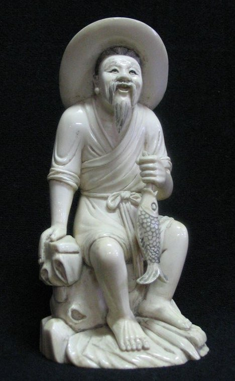 21017: Simulated ivory figure of a man holding a fish,