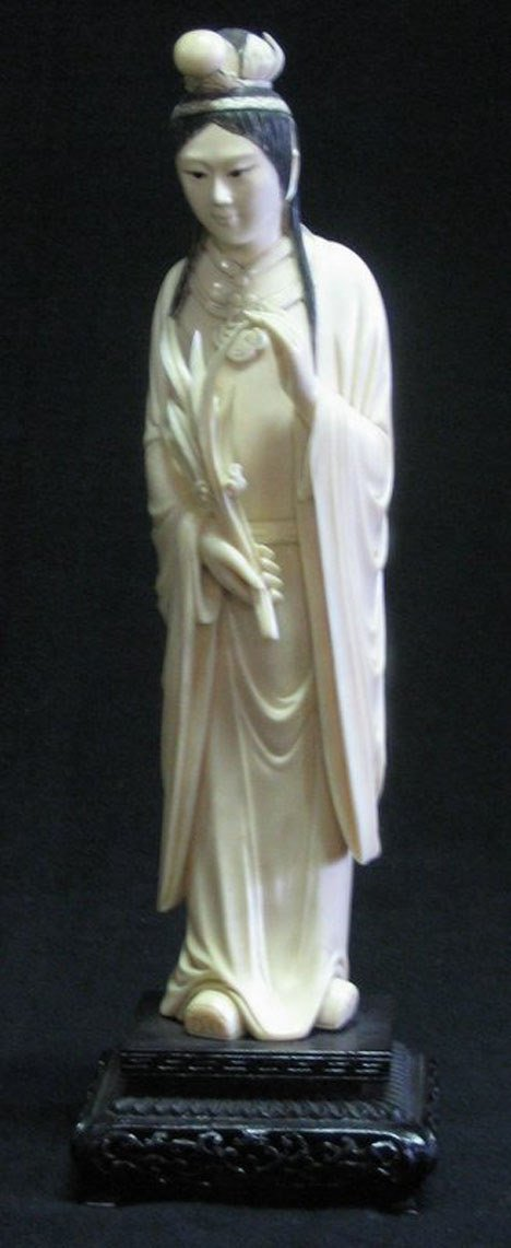 21021: Chinese carved ivory figure of a meiren holding