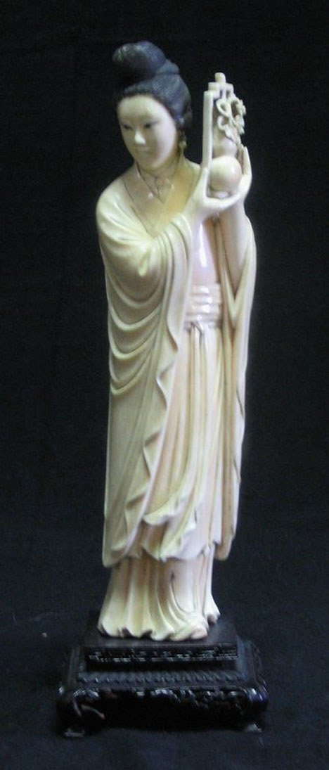 21022: Chinese carved ivory figure of a meiren holding