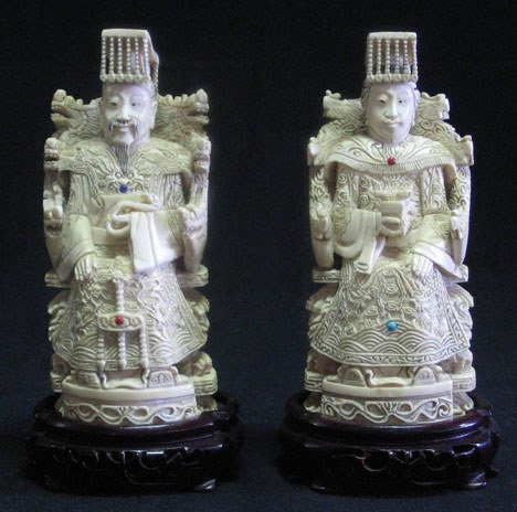 21023: Pair of Chinese carved ivory seated figures, ear