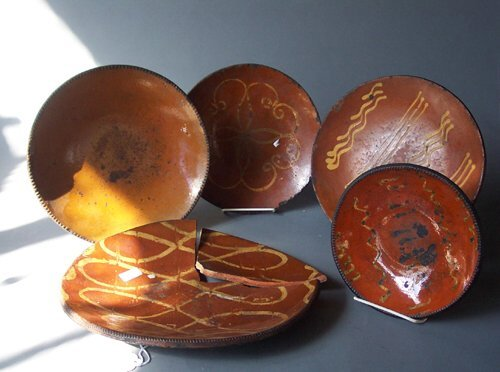 23: FIVE SLIP-DECORATED REDWARE PLATES  Penns