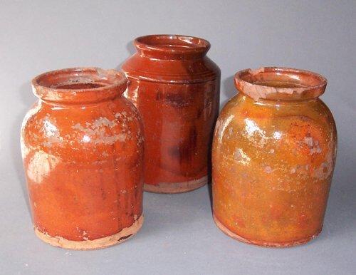 24: THREE GLAZED REDWARE JARS  Probably Penns