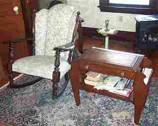 CARVED BEECHWOOD AND UPHOLSTERED ROCKING