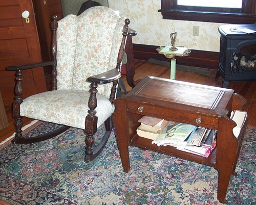 515: CARVED BEECHWOOD AND UPHOLSTERED ROCKING