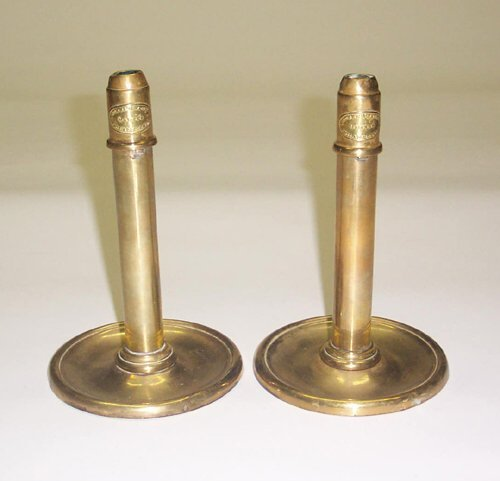 6: PAIR OF SPRING-LOADED BRASS CANDLESTICKS