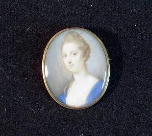 MINIATURE OF FEMALE IN BLUE DRESS 19th c. Gold cased