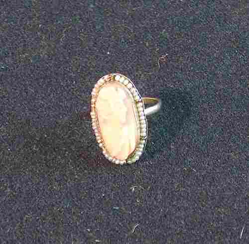 LADY'S 10K YELLOW GOLD RING Set with an oval pink c