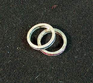 """TWO WHITE GOLD GUARD RINGS With channel-set ruby"""" a"""