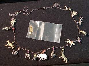 TWO LADY'S NECKLACES 20th c. With 17 various metal