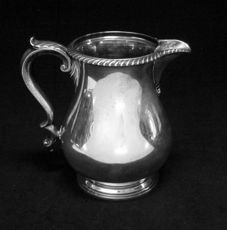 3152: Sterling silver pear-shaped water pitcher, gorham
