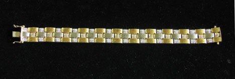 21615: 14 karat yellow and white gold flexible bracelet