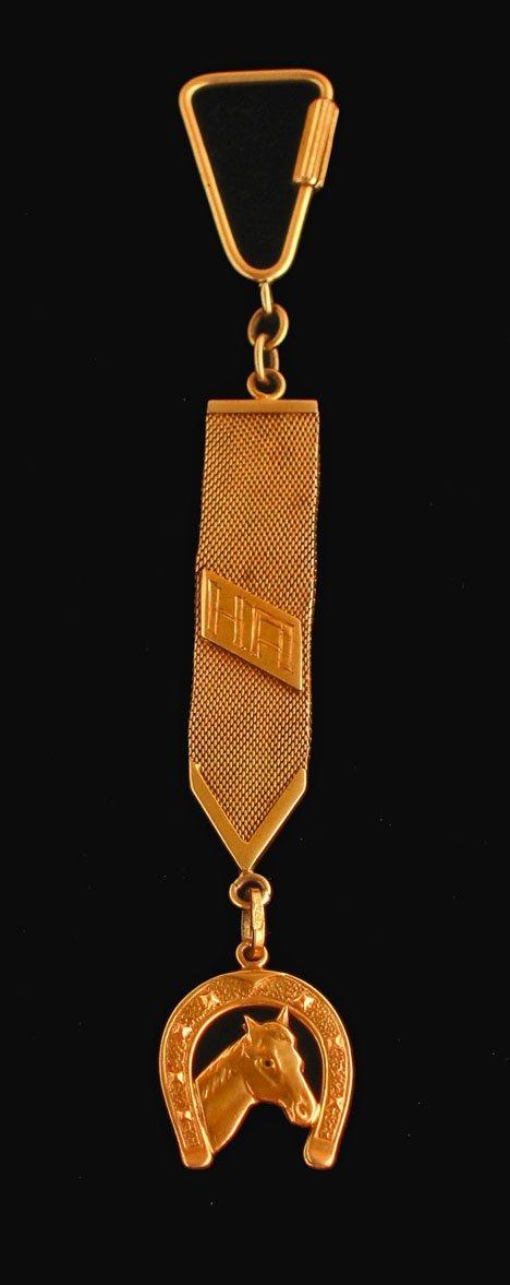 "21620: 18 karat yellow gold Art Deco horse"" watch fob,"