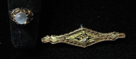 7: A Yellow Gold Moonstone Ring and Filigree Bar Pin, ,