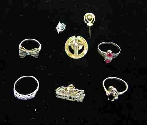 19A: Seven piece Group of Gold Rings, Stick Pin and Lap
