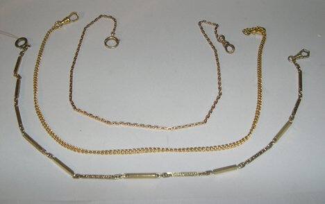 1005: THREE ASSORTED GOLD WATCH CHAINS One stamped 14k.