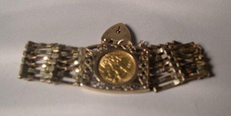 1005A: 10K YELLOW GOLD WIDE FLEXIBLE BRACELET Inset wit