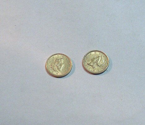 1016: TWO U. S. 1853 ONE DOLLAR GOLD PIECES