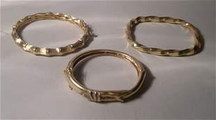 THREE YELLOW GOLD BANGLES Twist bamboo & chased h
