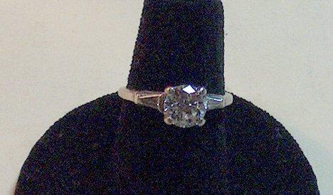 1168: PLATINUM & DIAMOND ENGAGEMENT RING Having a round