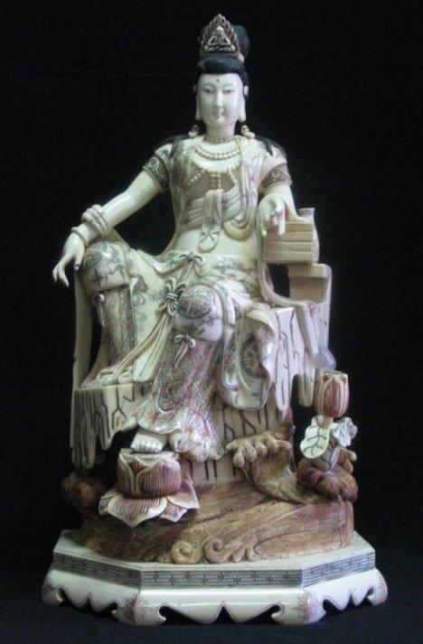 2592: Veneered bone figure of a goddess, , Seated on a