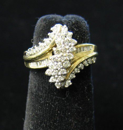 1017: 10K Yellow Gold and Diamond Ring, , Set with a sc