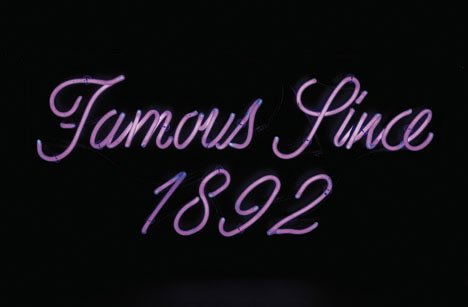 5: Famous Since 1892 neon sign, , Mounted within a blac