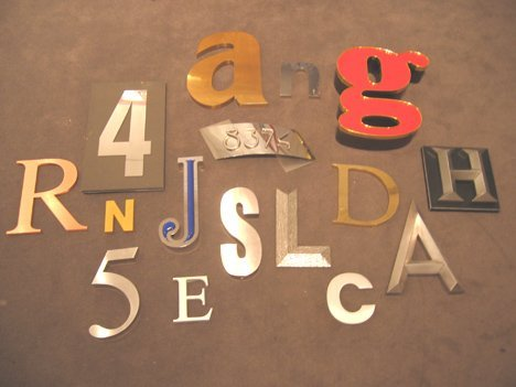 9: Sixteen assorted individual metal letters and number