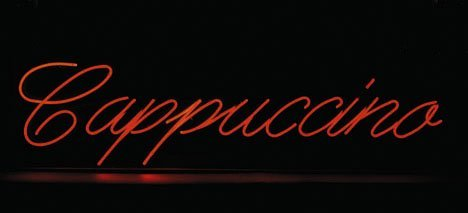 18: Cappuccino neon sign, , Mounted within a black enam