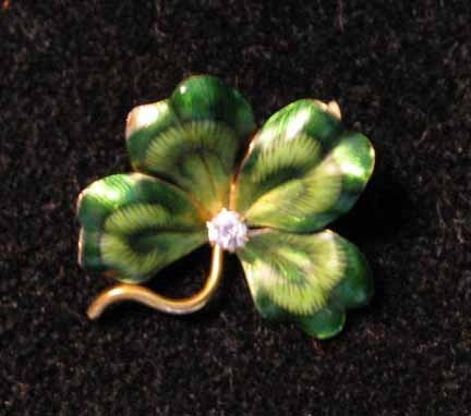 1005: 14 karat yellow gold and green enamel Four Leaf C