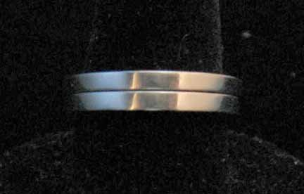 1008: Two 18 karat white gold bands, , Plain rectangula