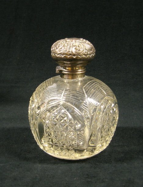 3009: Late Victorian silver mounted cut glass scent bot