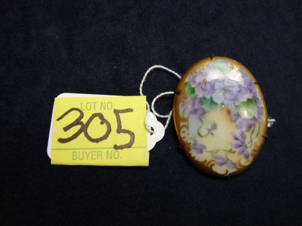 305: Pin, handpainted china with purple flowers, oval,