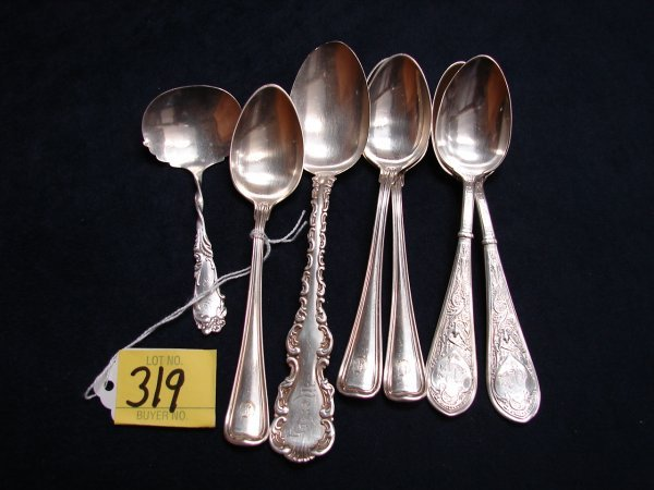 319: 7 sterling silver spoons, all monogrammed, 2 are N