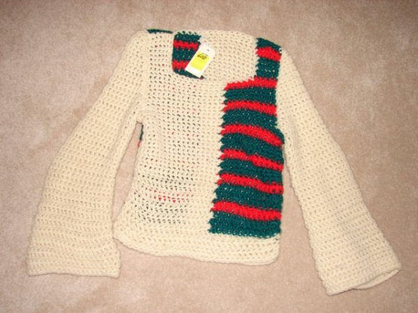 608: Crocheted sweater, tan with green and red wool? 24