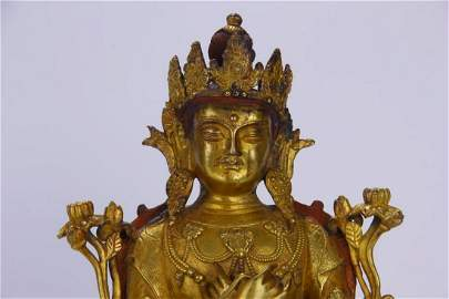 IMPORTANT AND MAJESTIC CHINESE GILT BRONZE SEATED