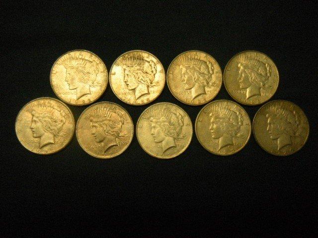 12: 9 Peace Silver Dollars