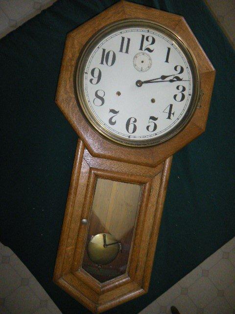 23: Oak Regulator Clock from Concord Junction R.R. Stat