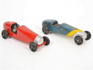 Two Painted Pinewood Derby Racers