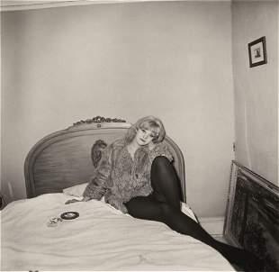 Diane Arbus, Girl in Coat Lying on her Bed, N.Y.C.,