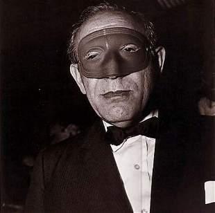 Diane Arbus, Masked man at a ball - 1967