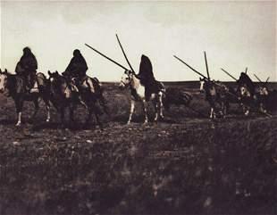 EDWARD CURTIS, 1900 Atsina Warriors On Horses