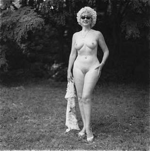 Diane Arbus, Nudist lady with swan sunglasses, 1965