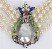 A fourrow faux pearl necklace centred by an enamelled
