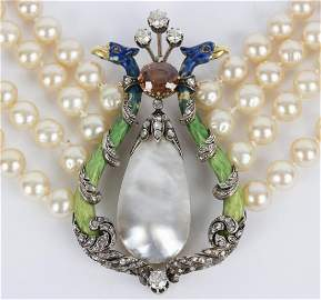 A four-row faux pearl necklace centred by an enamelled